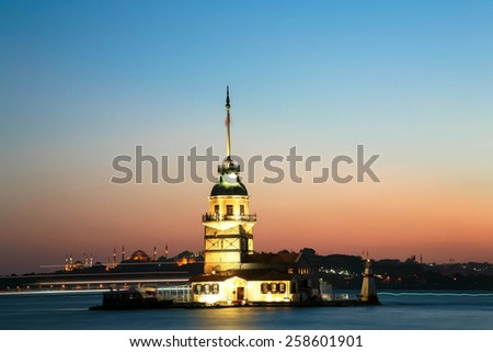 Istanbul Maiden Tower from the east in sunset. In the distance are such landmarks as Blue Mosque, Hagia Sophia and Topkapi Palace - stock photo