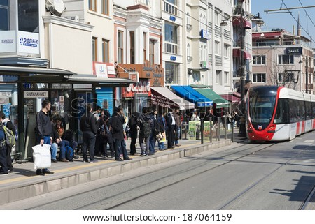 ISTANBUL - March 14: A modern tram on Sirkeci on March 14, 2014 in Istanbul. Due to increasing traffic & air pollution, Istanbul became one of most polluted city also planned for return of tram.  - stock photo