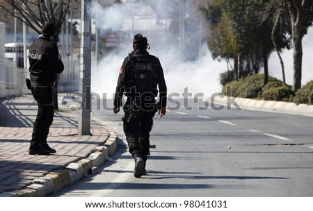 ISTANBUL - MARCH 18: Turkish police released gas bomb at Newroz demonstrations. Kurds celebrating their traditional feast Newroz that means 'new day' in kurdish on March 18, 2012 in Istanbul, Turkey.