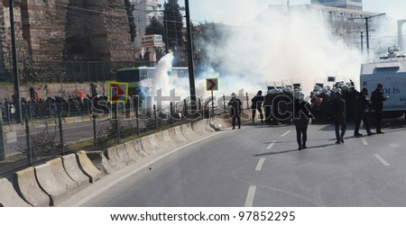 ISTANBUL - MARCH 18: Turkish police released gas bomb in Newroz in Topkapi. Kurds celebrating their traditional feast Newroz that means 'new day' in kurdish on March 18, 2012 in Istanbul, Turkey.