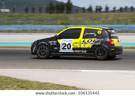 ISTANBUL - MAY 12: Ayhan Germirli of Loft Oil T-Max Racing Team drives a Super class Renault Clio car during 2012 Turkish Touring Car Championship, Istanbul Park on May 12, 2012 in Istanbul, Turkey. - stock photo