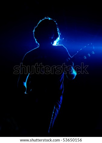 ISTANBUL - MAY 14: Band Mor ve Otesi performs live at Maltepe open air stage on May 14, 2010 in Istanbul, Turkey. Guitarist Kerem ?zyegen of the rock group plays - stock photo