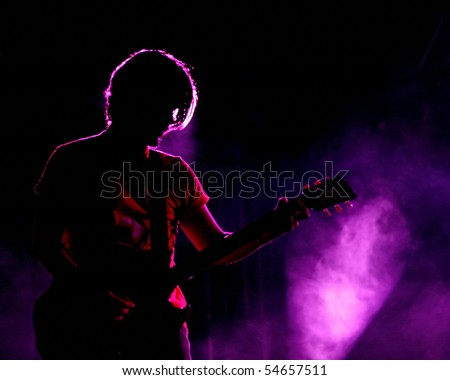 ISTANBUL - MAY 14: Band Mor ve Otesi performs live at Maltepe open air stage on May 14, 2010 in Istanbul, Turkey. Guitarist Kerem ozyegen of the rock group plays. - stock photo