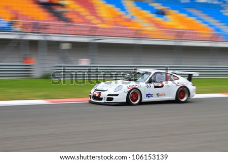 ISTANBUL - MAY 13: Cenk Ceyisakar drives a Porsche 997 GT3 car during 2nd race of 2012 Vizio GT3 Challence, Istanbul Park on May 13, 2012 in Istanbul, Turkey. - stock photo