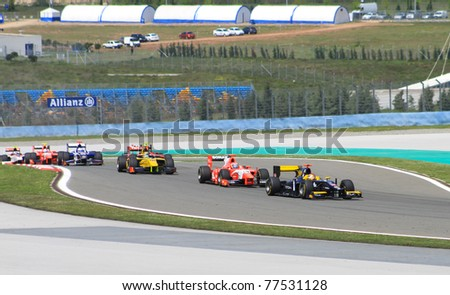 ISTANBUL - MAY 08: GP2 cars at second and third turn during GP2 Series Race 2, Istanbul Park on May 08, 2011 Istanbul, Turkey - stock photo