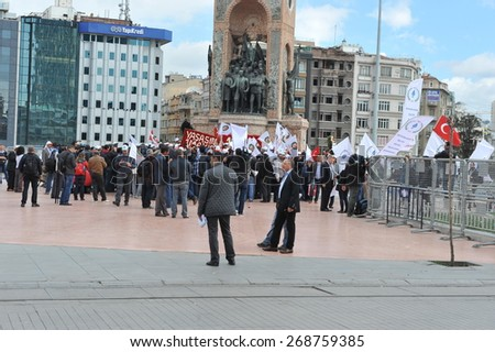 ISTANBUL - MAY 1: Many people can't take part in May Day march on May 1, 2014 in Istanbul. Police blocked all the ways to Taksim Square to prevent activists from joining their mates.  - stock photo
