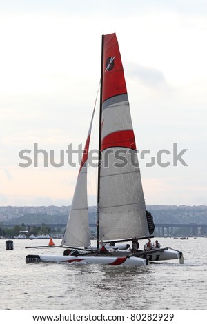 ISTANBUL - MAY 29: Skipper Tanguy Cariou, Alinghi Team boat competes in the Extreme Sailing Series, on May 29, 2011 Istanbul, Turkey. - stock photo