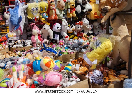 ISTANBUL - May 14, 2014 - Stuffed animals and other children's toys in the Grand Bazaar (Kapali carsi ) in Istanbul, Turkey - stock photo