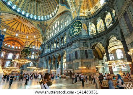 ISTANBUL - MAY 25, 2013: Tourists visiting the Hagia Sophia on may 25, 2013 in Istanbul, Turkey. Hagia Sophia is the greatest monument of Byzantine Culture. It was built in the 6th century. - stock photo