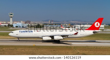 ISTANBUL - MAY 26: Turkish Airlines Airbus A340-311 accelerate to takeoff at Ataturk Airport on May 26, 2013 in Istanbul, Turkey. Airbus A340 introduced in 1993 and 377 aircraft produced. - stock photo