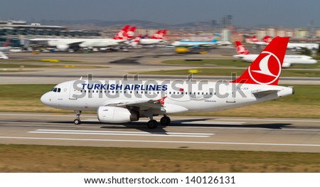 ISTANBUL - MAY 26: Turkish Airlines Airbus A319-132 accelerate to takeoff at Ataturk Airport on May 26, 2013 in Istanbul, Turkey. TA has 14 Airbus A319 with 132 seating capacity. - stock photo
