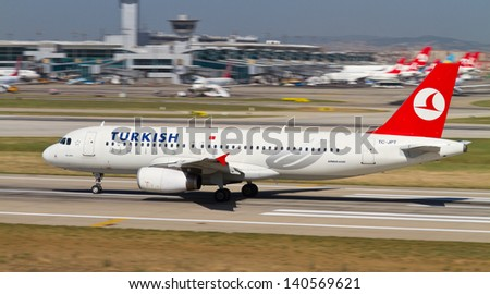 ISTANBUL - MAY 26: Turkish Airlines Airbus A320-232 accelerate to takeoff at Ataturk Airport on May 26, 2013 in Istanbul, Turkey. Ataturk Airport has 45 million passenger capacity in 2012. - stock photo