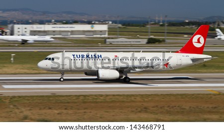 ISTANBUL - MAY 26: Turkish Airlines Airbus A320-232 accelerate to takeoff at Ataturk Airport on May 26, 2013 in Istanbul, Turkey. Airbus A320 introduced in 1988, has 180 maximum seating capacity. - stock photo