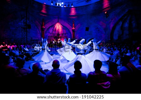 ISTANBUL - MAY 20: Whiriling dervishes perform religious dance ceremony on May 20, 2011 in Istanbul. - stock photo