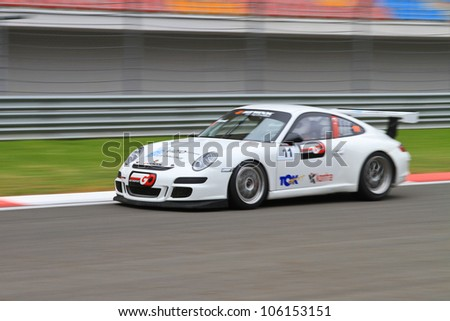 ISTANBUL - MAY 13: Yucel Ozbek drives a Porsche 997 GT3 car during 2nd race of 2012 Vizio GT3 Challence, Istanbul Park on May 13, 2012 in Istanbul, Turkey. - stock photo