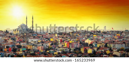 Istanbul Mosque Suleymaniye with colorful residential area in sunset with orange sky - stock photo