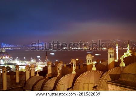 Istanbul. Night. Cloudy. View to the Bosphorus Strait, Galata Bridge, Bosphorus Bridge and Medrese-i Rabi roofs. A lot of ships - stock photo