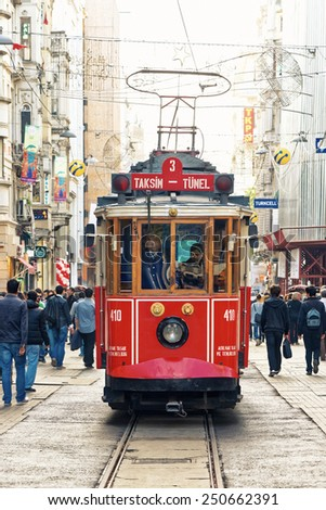 ISTANBUL - NOV, 21: A red classic tram in the crowded Istiklal Avenue in the Beyoglu district of Istanbul, Nov 21, in Istanbul, Turkey 2013 - stock photo