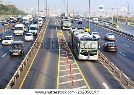 ISTANBUL - NOV 2, 2013: Trans-European Motorway in Istanbul. Express Metrobus Line planed as a solution to transport problem in city with a daily capacity of 800,000 passengers/day.  - stock photo