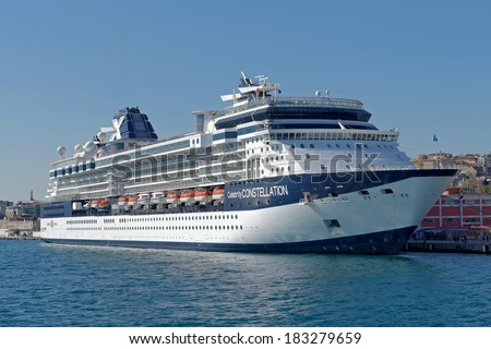 ISTANBUL - OCTOBER 20: Celebrity Cruise's Constellation, docked in port on October 20, 2013 in Istanbul. Karakoy Port receives 15,000 passengers in only one day with 5 cruise ships. - stock photo
