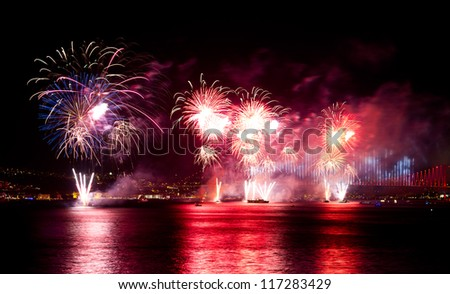 ISTANBUL - OCTOBER 29: Fireworks over Bosphorus Strait during Turkish Republic day celebrations on October 29, 2012 in Istanbul, Turkey