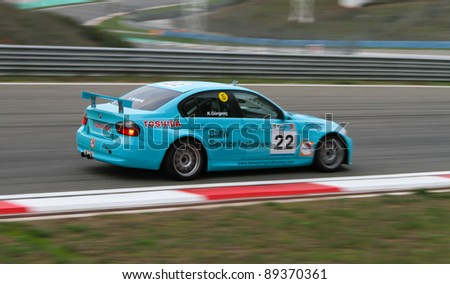 ISTANBUL - OCTOBER 30: Kaan Gurgenc drives a BMW 320 SI car during Turkey  Track Championship on October 30, 2011 in Istanbul, Turkey - stock photo