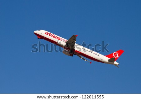 ISTANBUL - SEPTEMBER 08: Atlasjet Airbus A321 take off from IST on September 08, 2012 in Istanbul, Turkey. Atlasjet operating scheduled passenger services and charter flights by 14 aircrafts. - stock photo