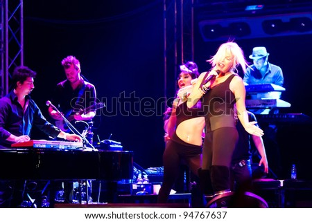 ISTANBUL - SEPTEMBER 18: Pop star Ajda Pekkan performs live during a concert at Maltepe on September 18, 2011 in Istanbul, Turkey.