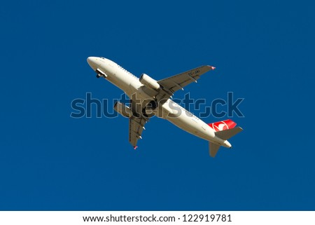 ISTANBUL - SEPTEMBER 08: Turkish Airlines Airbus A320 takeoff from IST on September 08, 2012 in Istanbul, Turkey. Airbus A320 was launched in 1984, a total of 5,232 aircraft have been delivered. - stock photo
