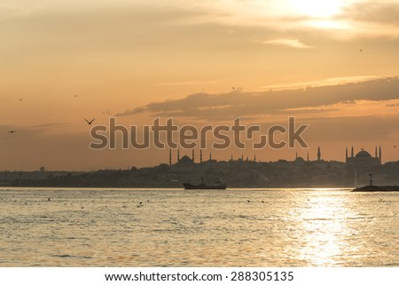 Istanbul silhouette. Blue Mosque and Hagia Sophia at sunset. Turkey - stock photo
