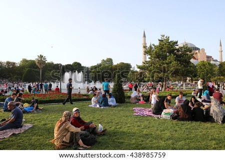 Istanbul, Sultanahmet Square/Turkey - June 18 2016: Documentary Editorial Image showing that Turkish People waiting for the sunset gun to break their ramadan fast (iftar)  on the grass.