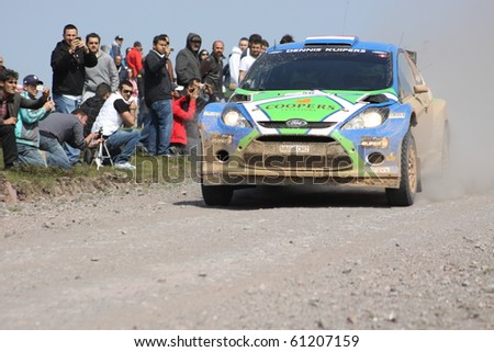 ISTANBUL, TURKEY - APRIL 18: Dennis Kuipers drives a Stobart M-Sport Ford Team Ford Fiesta S2000 car during Rally of Turkey 2010 WRC championship, Ballica Stage on April 18, 2010 in Istanbul, Turkey - stock photo