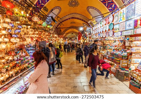 ISTANBUL, TURKEY - APRIL 10, 2015: Grand Bazaar in Istanbul with unidentified people. It is one of the largest and oldest covered markets in the world, with 61 covered streets and over 3,000 shops - stock photo