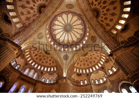 ISTANBUL, TURKEY - April 28: Interior decoration of the dome of Blue Mosque on April 28, 2013 in Istanbul. The Mosque was built from 1609 to 1616, during the rule of Sultan Ahmed I.  - stock photo