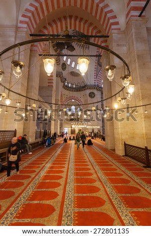 ISTANBUL, TURKEY - APRIL 09, 2015: interior view of the Sueleymaniye Mosque with unidentified people. It is the largest mosque in the city, and one of the best-known sights of Istanbul.