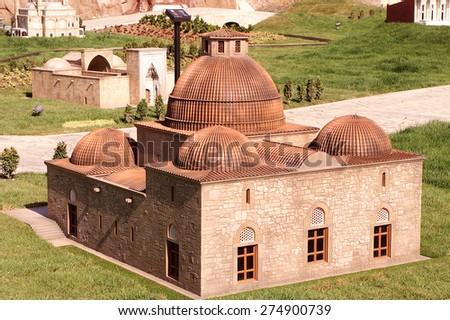 ISTANBUL, TURKEY - APRIL 30: Karatay Madrasah of Konya at the Miniaturk miniature park on Golden Horn on April 30, 2005 in Istanbul, Turkey. Miniaturk is one of the world's largest miniature parks. - stock photo