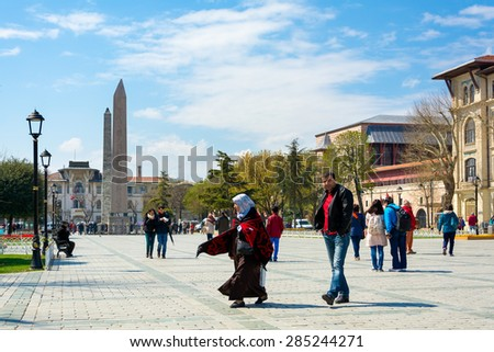 ISTANBUL, TURKEY - APRIL 08, 2015: Obelisk of Theodosius (Egyptian Obelisk) near Blue Mosque (Sultanahmet camii) in the ancient Hippodrome on April 08 Istanbul, Turkey - stock photo