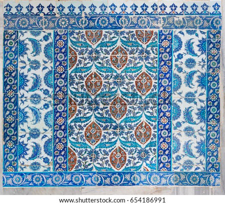 Istanbul, Turkey - April 24, 2017: Old ceramic wall tiles with floral blue pattern in an exterior wall of the historic Eyup Sultan Mosque situated in the Eyup district