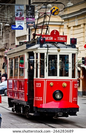 ISTANBUL, TURKEY - APRIL 14 : Red vintage tram on Taksim Istiklal Street on April 14, 2013 in Istanbul, Turkey. Taksim Istiklal Street is a popular destination in Istanbul. - stock photo