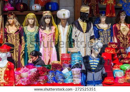 ISTANBUL, TURKEY - APRIL 10, 2015: traditional costume shop with unidentified person near Hagia Sophia in Istanbul. Istanbul is the largest city in Turkey and a famous travel destination