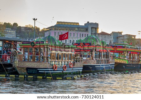 Istanbul, Turkey - April 25, 2017: Traditional fast food bobbing boats serving fish sandwiches at Eminonu