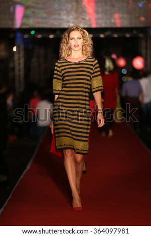 ISTANBUL, TURKEY - AUGUST 25, 2015: A model showcases one of the latest creations in Laleli Fashion Shopping Festival