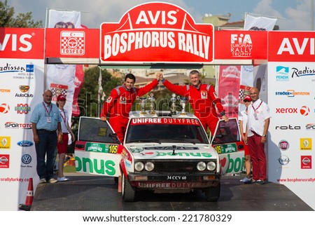 ISTANBUL, TURKEY - AUGUST 17, 2014: Burak Turkkan with Fiat 131 car of Bonus Unifree Parkur Racing Team in Podium Ceremony of Avis Bosphorus Rally