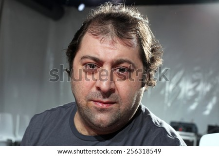 ISTANBUL, TURKEY - AUGUST 8: Famous Turkish actor, thespian and television series star Erdem Akakce portrait on August 8, 2011 in Istanbul, Turkey. - stock photo