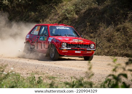 ISTANBUL, TURKEY - AUGUST 16, 2014: Kemal Gamgam drives Ford Fiesta MKI car in Avis Bosphorus Rally, Deniz Stage