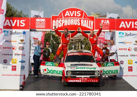 ISTANBUL, TURKEY - AUGUST 17, 2014: Kerem Ustunkaya with Ford Escort MKII car of Bonus Unifree Parkur Racing Team in Podium Ceremony of Avis Bosphorus Rally - stock photo