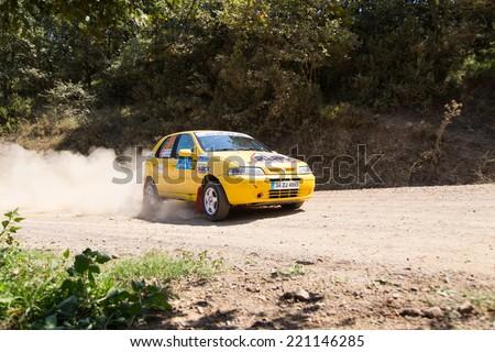 ISTANBUL, TURKEY - AUGUST 16, 2014: Murat Guray drives Fiat Palio car in Avis Bosphorus Rally, Deniz Stage - stock photo