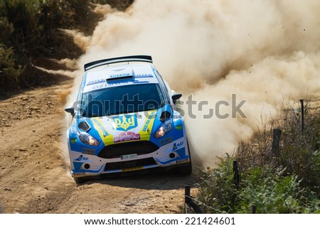 ISTANBUL, TURKEY - AUGUST 16, 2014: Oleksandr Saliuk drives Ford Fiesta R5 car in Avis Bosphorus Rally, Mudarli Stage - stock photo