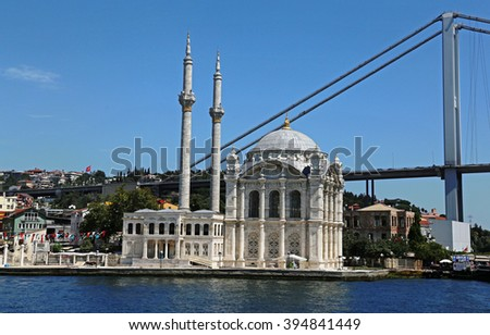 ISTANBUL, TURKEY - AUGUST 14, 2015: Ortakoy Mosque shot  from the Bosphorus.  It was completed in 1856. - stock photo