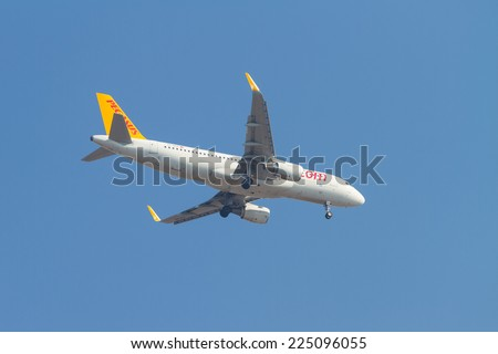 ISTANBUL, TURKEY - AUGUST 16, 2014: Pegasus Airlines Airbus A320-214 landing to Sabiha Gokcen Airport. Pegasus is the second largest airlines in Turkey with 54 airplanes. - stock photo